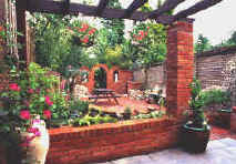 This garden design featured substantial brick work features, a timber pergola and yet plenty of planting within the garden design